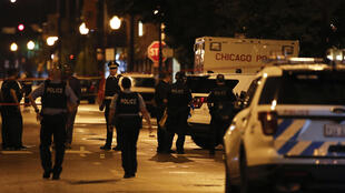 Fourteen people were wounded in the shootout outside a funeral parlor in Chicago