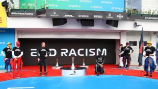 Lewis Hamilton kneels ahead of Sunday's Hungarian Grand Prix