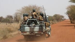 Burkina Faso soldiers patrol on the road of Gorgadji in the Sahel area in March 2019.