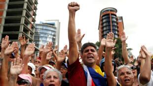 Opositores a Nicolás Maduro durante una manifestación en su contra. Caracas, Venezuela, el 23 de enero de 2018.