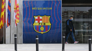 A police officer exits the offices of FC Barcelona on March 01, 2021.