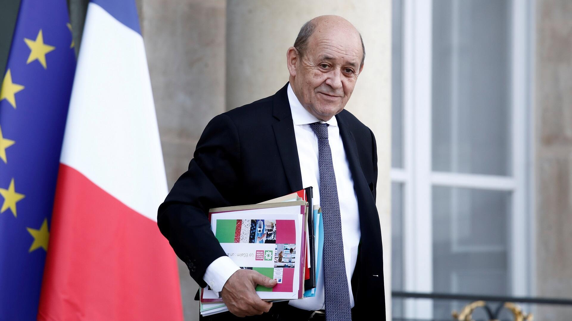 French Foreign Minister Jean-Yves Le Drian leaves the Élysée Palace following the weekly cabinet meeting in Paris, France, October 21, 2019.