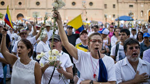 """À Cali, le 13 décembre 2014, des Colombiens réclament """"la paix sans impunité"""" pour les Farc."""