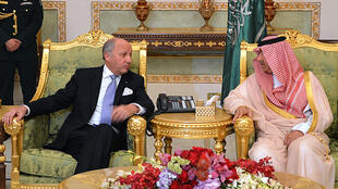 French Foreign Minister Laurent Fabius meets Saudi Deputy Minister of Foreign Affairs Abdulaziz bin Abdullah upon his arrival in the Saudi capital, Riyadh, on April 12.
