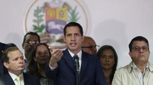 Venezuelan opposition leader Juan Guaido, who many nations have recognised as the country's rightful interim ruler speaks next to Venezuela's National Assembly first Vice President Juan Pablo Guanipa and second Vice President Carlos Berrizbeitia during a news conference in Caracas, Venezuela January 6, 2020.