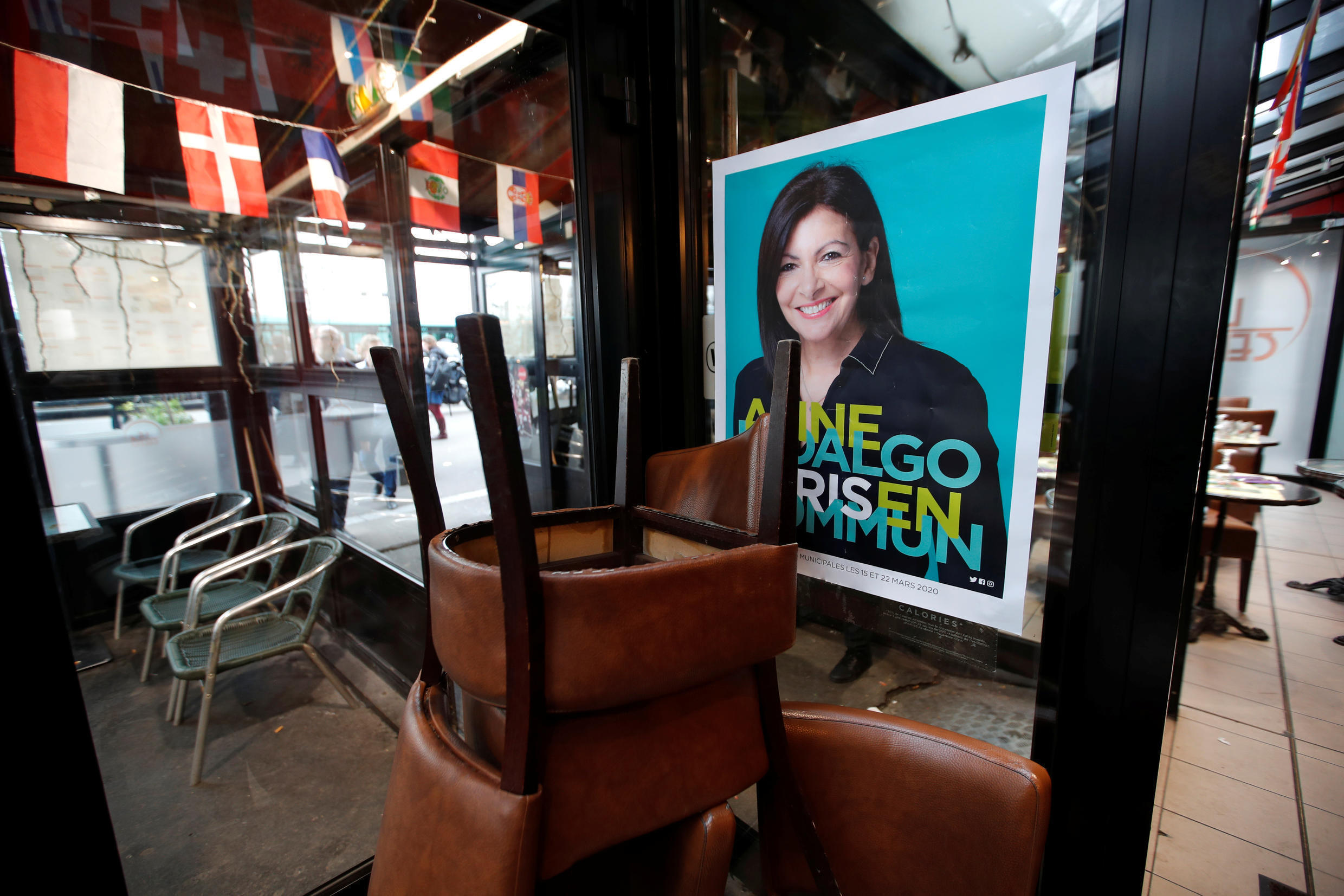 An electoral campaign poster of Paris Mayor Anne Hidalgo is displayed in a Paris restaurant on January 13, 2020.