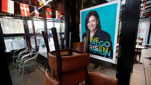 A campaign poster for Anne Hidalgo's mayoral re-election bid in a Paris restaurant on January 13, 2020.