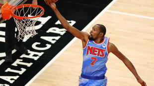 Brooklyn's Kevin Durant returned to practice Friday after missing three games under NBA Covid-19 safety protocols and will return to action on Saturday at Golden State