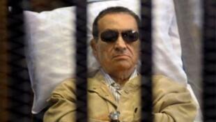 صورة أرشيفية أثناء محاكمة الرئيس المصري الأسبق حسني مبارك