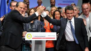 """Jean-Christophe Cambadélis, premier secrétaire du Parti socialiste, et Manuel Valls, Premier ministre, lors d'une conférence de l'""""Université de l'engagement"""", à Tours, le 22 octobre 2016."""