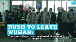 People enter Wuhan airport on Wednesday, April 8, 2020 as the outbound travel restrictions in the city were lifted.