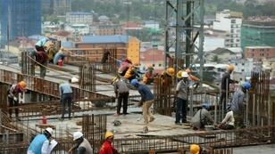 Tens of thousands of Cambodian day-labourers work on the mushrooming construction sites in Sihanoukville
