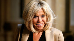Axel Schmidt / AFP | French President Emmanuel Macron's wife Brigitte Macron arrives to attend the partners' programme during the G20 summit in Hamburg, northern Germany, on July 8, 2017.