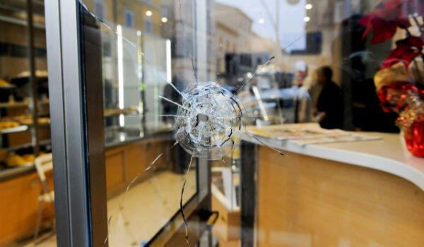 Bullet holes were found in shop windows and at the local branch of the ruling Democratic Party.