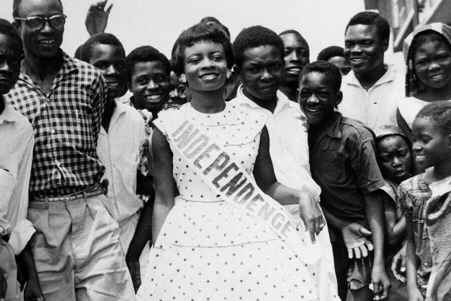 """Rosemary Anieze, wearing the sash of """"Miss Independence,"""" is popular as she parades outside the National Stadium in Lagos, Sept. 28, 1960, after winning the title from 15 other contestants in Nigeria."""