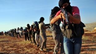Camp d'entraînement djihadiste près d'Alep, en Syrie, le 19 juillet  2012