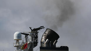 In this November 5, 2019 file photo, smoke pours from the smokestack on a container ship at Port Everglades in Fort Lauderdale, Florida.