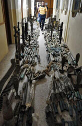 Iraqi police display weapons found at a cache allegedly belonging to al-Qaeda militants in the Iraqi city of Ramadi, 100 km west of Baghdad, on August 28.
