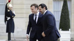 الرئيس الفرنسي إيمانويل ماكرون مستقبلا رئيس الوزراء اللبناني المستقيل سعد الحريري 18 تشرين الثاني/نوفمبر 2017