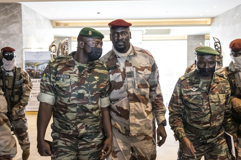Colonel Mamady Doumbouya (c), seen here on September 17, was sworn in as Guinea's interim president