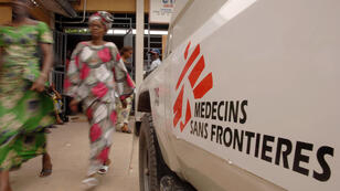Health workers treat a possible Ebola patient inside a Doctors Without Borders-supported Ebola Treatment Center in east Democrat