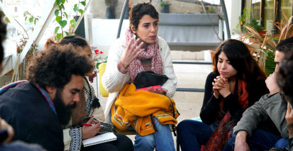 Journalist and blogger Henda Chennaoui (centre) speaks during a meeting of Fech Nestanew activists in Tunis on January 15, 2017.
