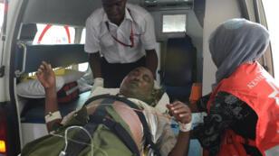 An injured student arrives at Kenyatta National Hospital in Nairobi.