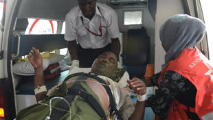 An injured student arrives at Kenyatta National Hospital in Nairobi.