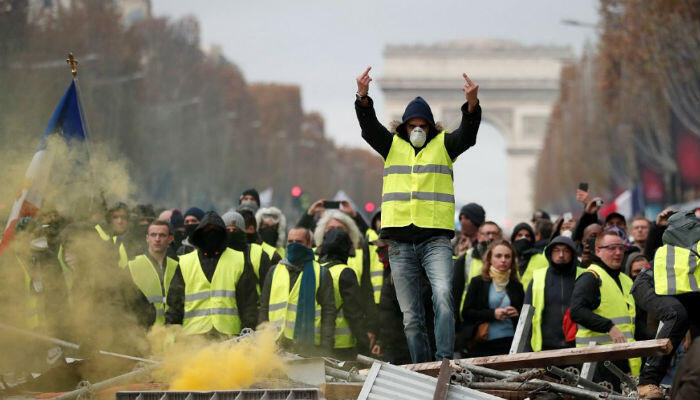 Benoit Tessier, Reuters | A protester wearing a yellow vest gestures during clashes on the Champs-Élysées in Paris, France, November 24, 2018.