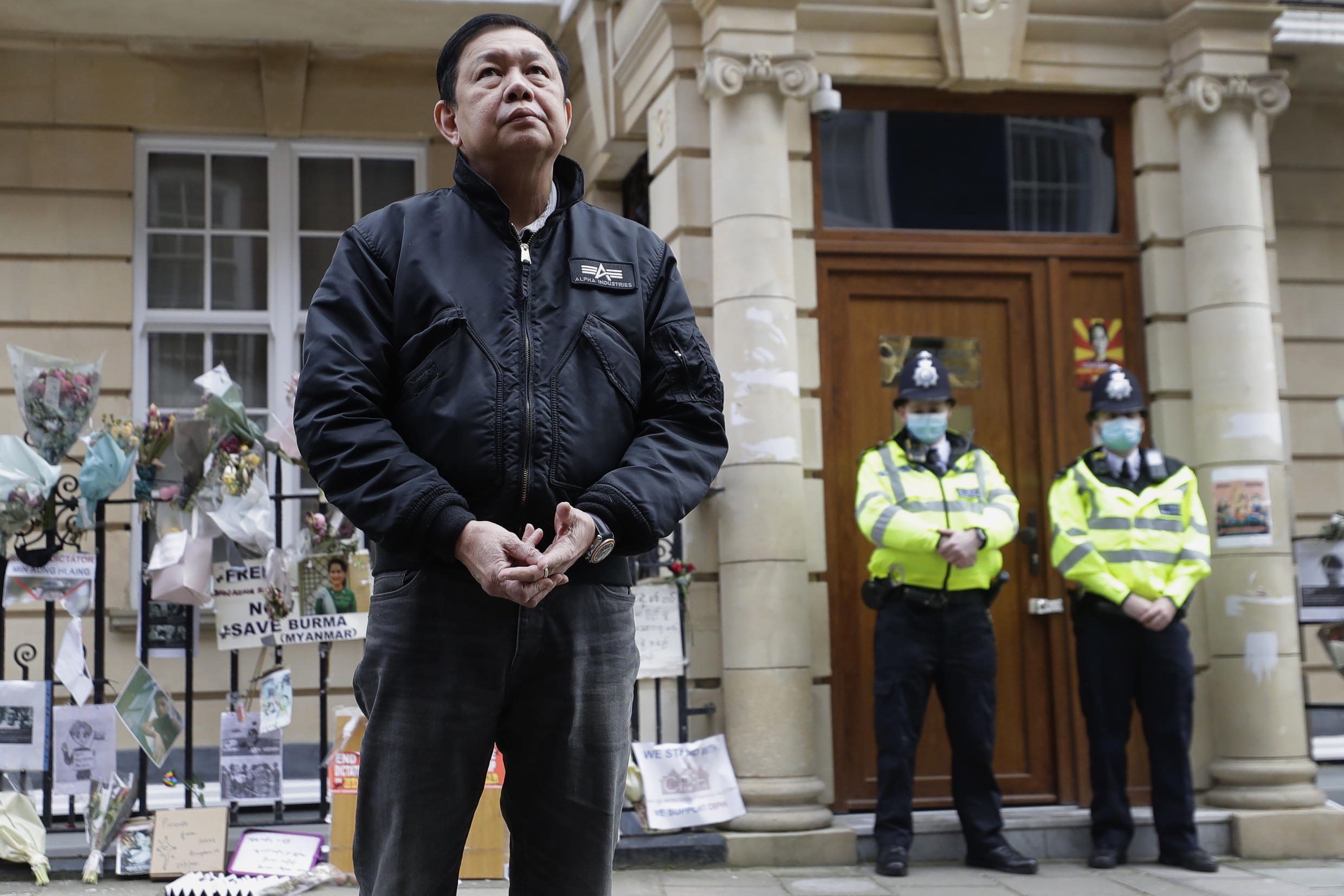 Kyaw Zwar Minn, Myanmar's ambassador to London, stands in front of the Myanmar embassy as a statement is read on his behalf in London, Thursday, April 8, 2021.