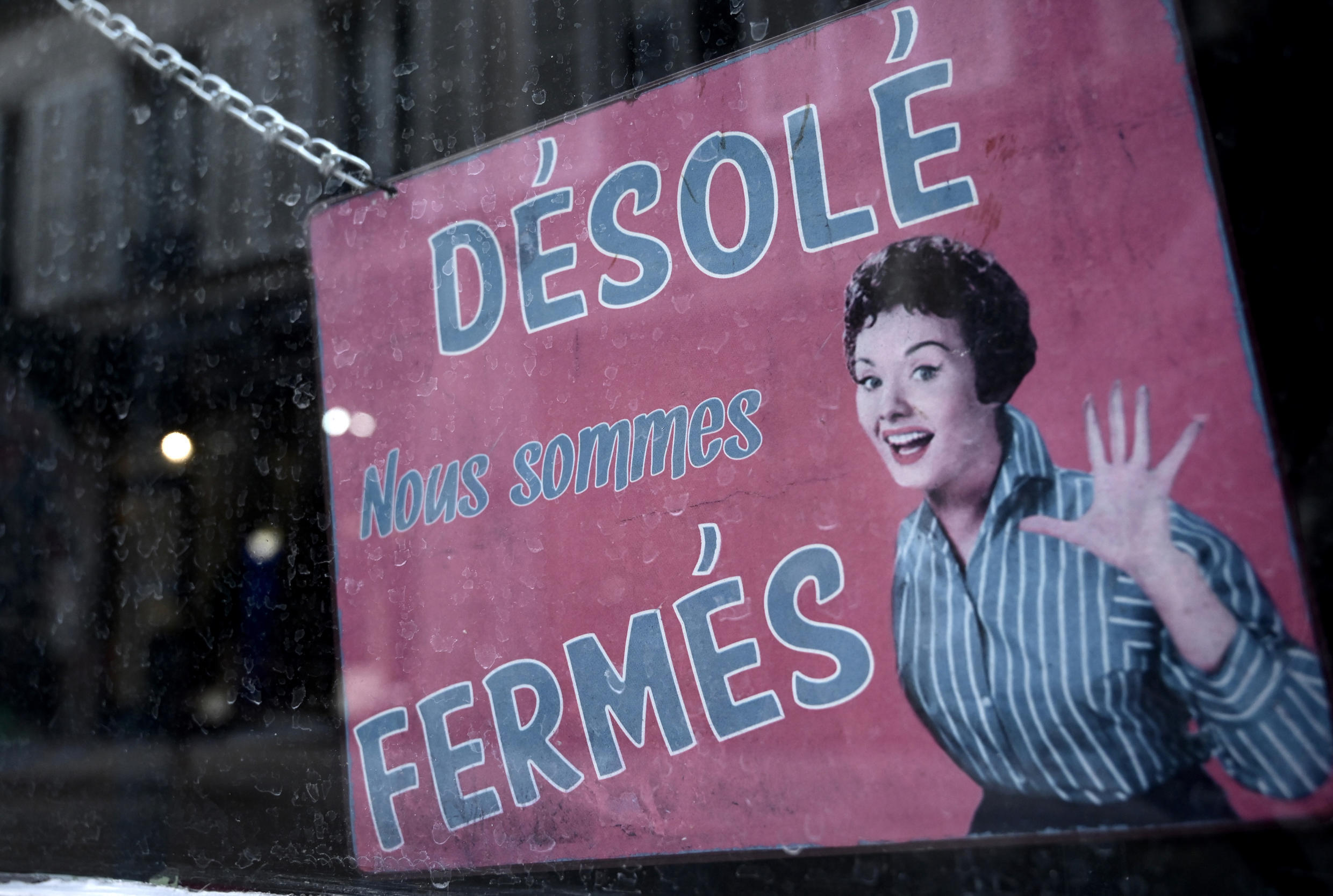 "A shop in Paris carries the sign, ""Sorry, we are closed."""