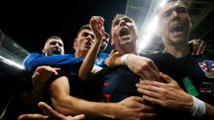 Le Croate Mario Mandzukic fête le deuxième but de son équipe dans le match contre l'Angleterre, le 11 juillet au stade Loujniki de Moscou.