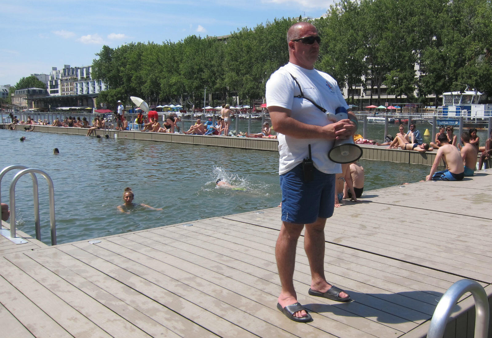 """David Rigaudie, the head of """"La Baignade's"""" 16 lifeguards, stands watch to ensure visitors stay safe in the water."""