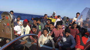 Migrants are seen here being rescued in June 2020 by activists from the French NGO SOS Mediterranee off the coast of Libya, a major transit point for migrants seeking to make their way from Africa into Europe