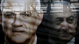 A banner in Tel Aviv, Israel, depicting Benny Gantz, leader of Blue and White party, left, and Prime Minister Benjamin Netanyahu, as part of Blue and White party's campaign ahead of the March 2, 2020, election in Israel.