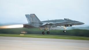 One of Canada's fleet of 88 aging CF-18 Hornets takes off from a base in Bagotville, Quebec
