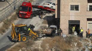 Cette photo prise le 22juillet2019 montre les forces de sécurité israéliennes se préparant à démolir des habitations palestiniennes, au sud de Jérusalem.