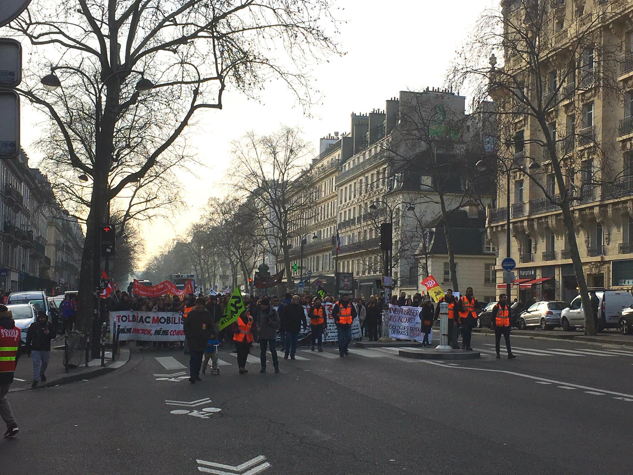Protesters head down the Boulevard Filles du Calvaire, just in front of the Repaire du Cartouche restaurant, for a seventh day of nationwide protests.