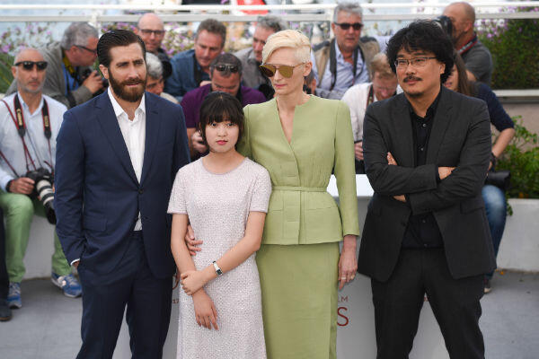 """From left to right: Jake Gyllenhaal, An Seo-hyun, Tilda Swinton and director Bong Joon-ho attend the Cannes photocall for """"Okja""""."""