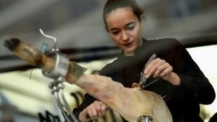 Spanish ham cutter Raquel Acosta shows her skills as more women enter the man's world of high-level cutters of Spain's famous dry-cured ham legs