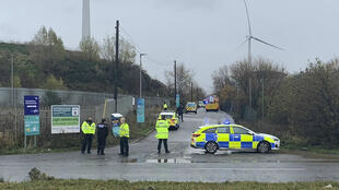 In this photo taken with permission from the Twitter feed of @jawadburhan98, police officers attend the scene of a 'large' explosion, near Bristol, UK on December 3, 2020.