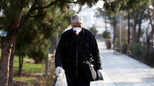 A man wears a protective mask against coronavirus on a street in Tehran on February 29, 2020.