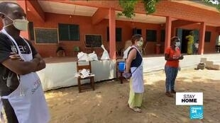 Volunteers wait to hand out food in Benin.