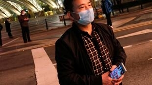 A man wearing mask walks in front of Casino Lisboa, before its temporary closing, following the coronavirus outbreak in Macau, China February 4, 2020.