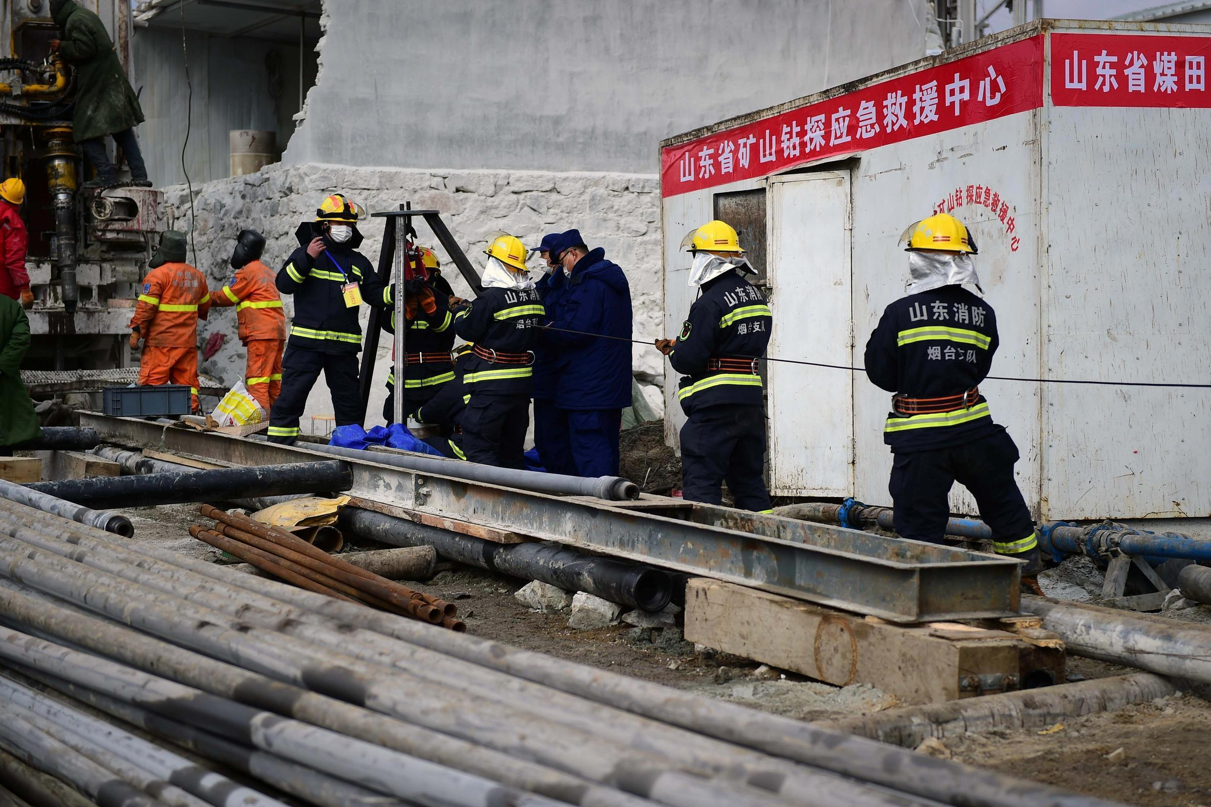 A rescue team works on retrieving 22 miners trapped underground in eastern China's Shandong province