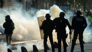 """Clouds of tear gas fill the street during a """"yellow vest"""" demonstration in the western French city of Nantes"""