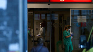 Healthcare workers are pictured at the emergency unit at La Paz hospital during the coronavirus disease (COVID-19) outbreak in Madrid, Spain, March 23, 2020.