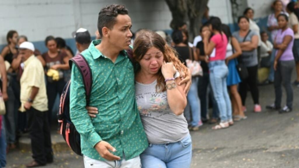 Families demand answers after 29 inmates die in Venezuela