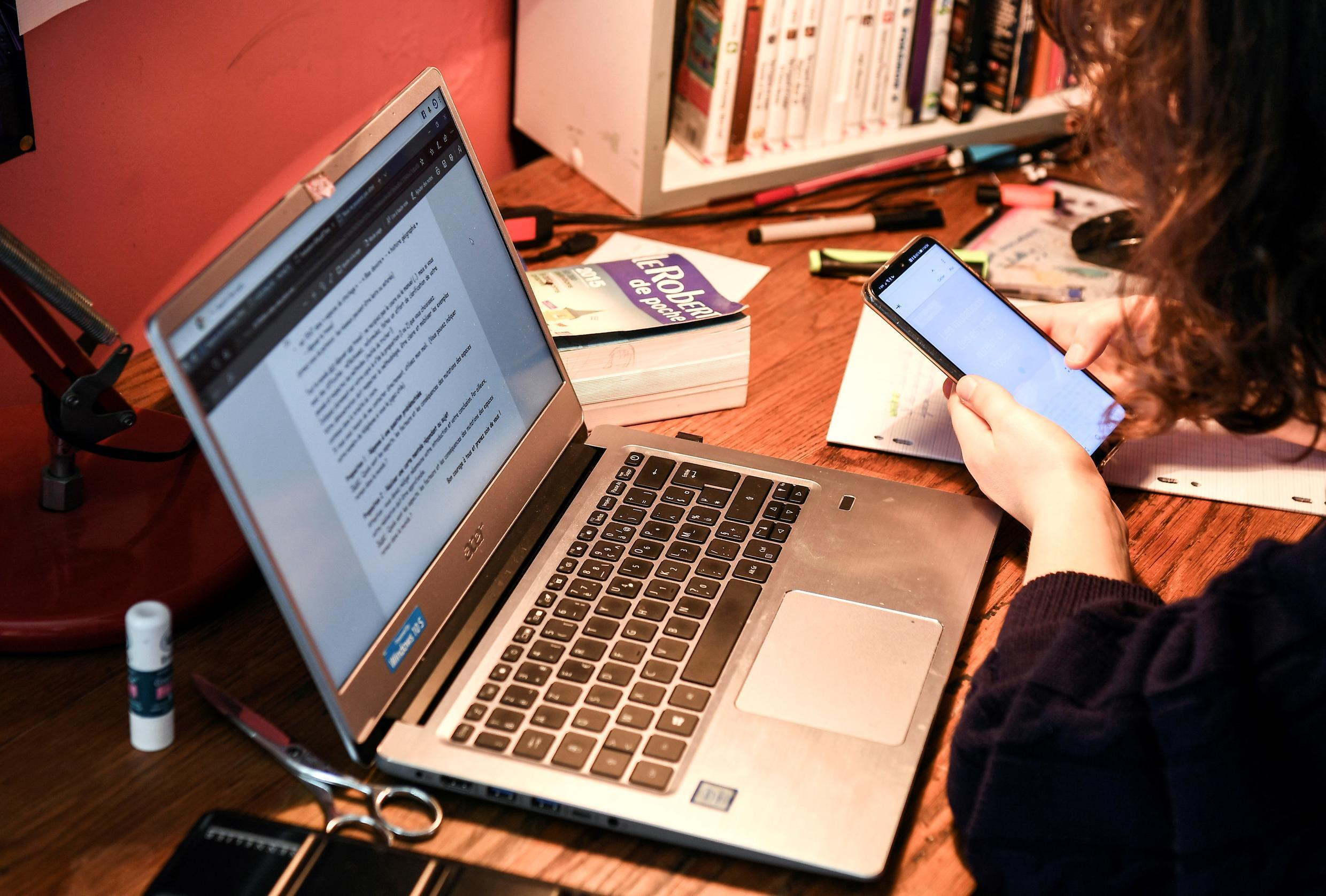 A French student follows a university course online in her room on March 27, 2020, during the lockdown due to the coronavirus outbreak.