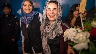 "Moroccan journalist Hajar Raissouni (R) is greeted upon leaving a prison in Sale near the capital Rabat on October 16, 2019. Raissouni who was sentenced to one year in jail for an ""illegal abortion"" and sexual relations outside marriage walked free today, hours after being granted a royal pardon."